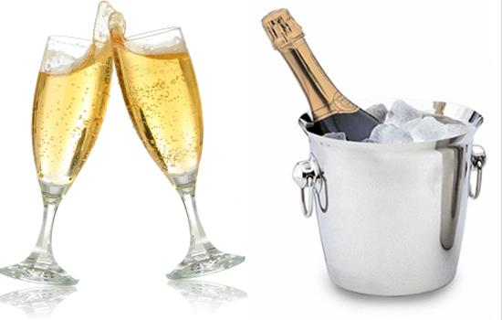 Two champagne glasses & champagne bottle in bucket of ice